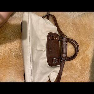 Coach handbag with adjustable crossbody strap
